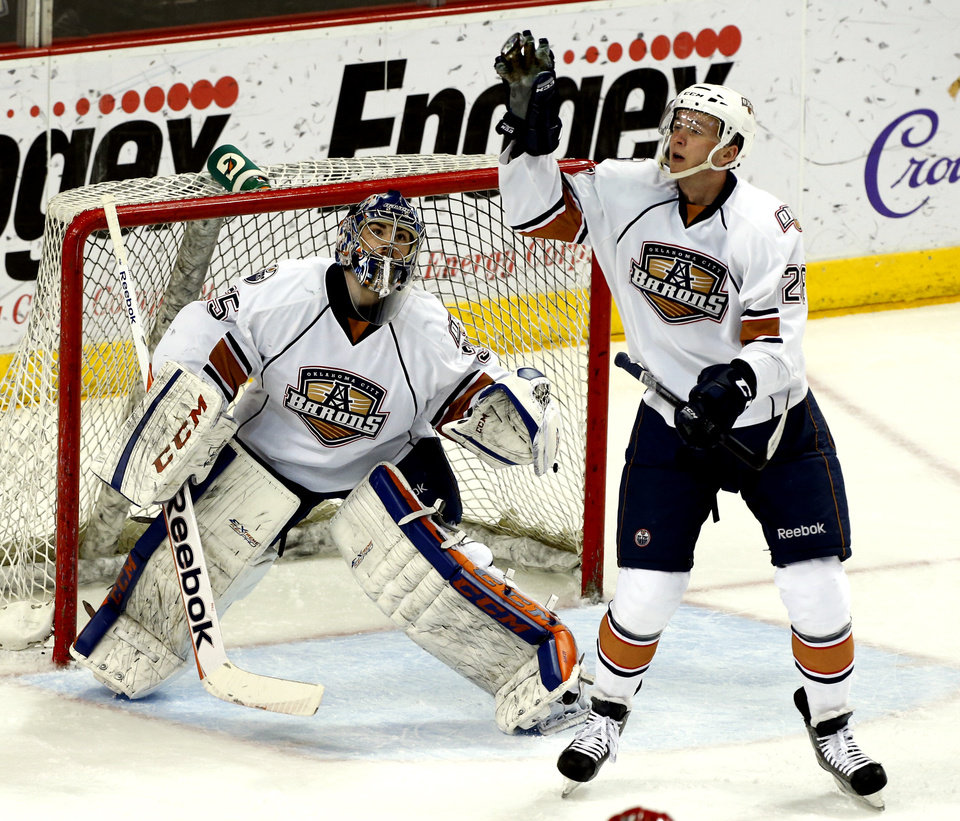 Baron's Martin Marincin catches the puck as goalie Yann Danis watches in the first period during Game 2 of the AHL hockey playoff series between the Oklahoma City Barons and the Charlotte Checkers at the Cox Center in Oklahoma City, on Saturday, April 27, 2013.  Photo by Steve Sisney, The Oklahoman