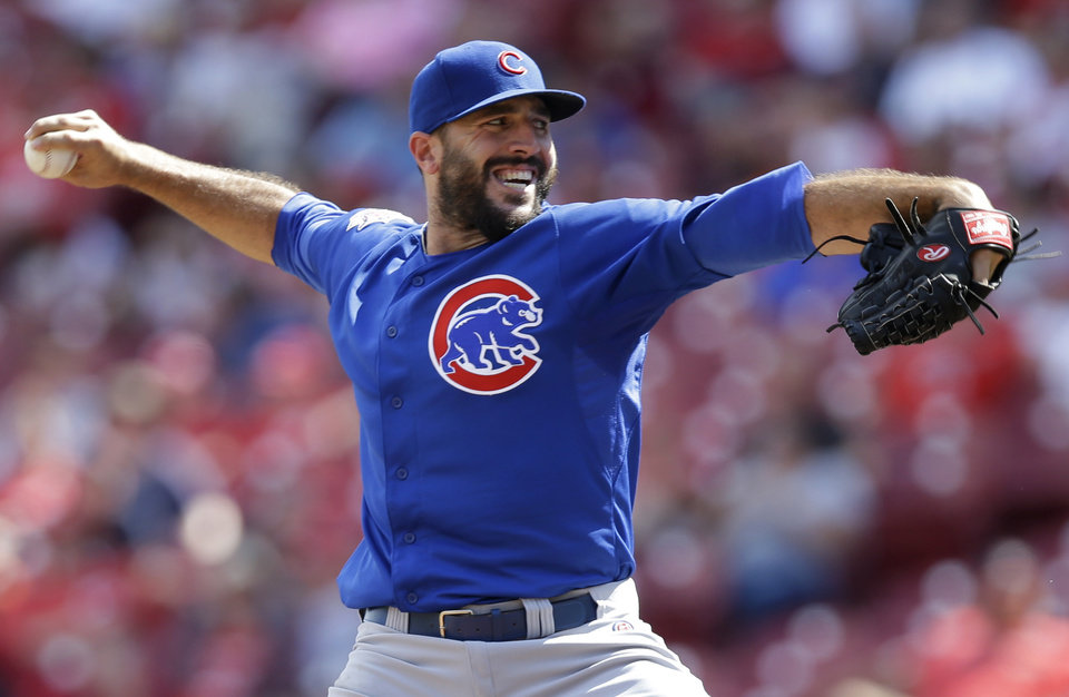Photo - Chicago Cubs relief pitcher Blake Parker throws against the Cincinnati Reds in the 12th inning of a baseball game, Thursday, July 10, 2014, in Cincinnati. Parker was the winning pitcher in the game won by Chicago 6-4 in 12 innings. (AP Photo/Al Behrman)
