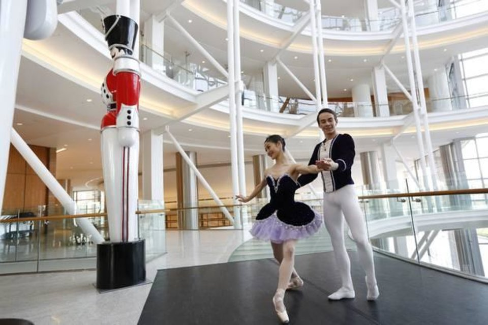 "Photo -  Oklahoma City Ballet dancers Miki Kawamura and Alvin Tovstogray perform in the rotunda of the Devon Energy Center in Oklahoma City on Thursday. Devon officials announced they are making a $500,000 contribution to completely renovate the OKC Ballet's annual production of ""The Nutcracker."" Photo By Steve Gooch, The Oklahoman"