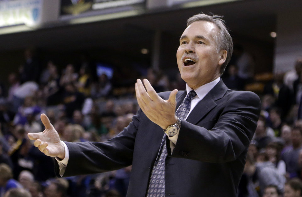 Photo - Los Angeles Lakers coach Mike D'Antoni questions a call in the first half of an NBA basketball game against the Indiana Pacers in Indianapolis, Friday, March 15, 2013.  (AP Photo/Michael Conroy)