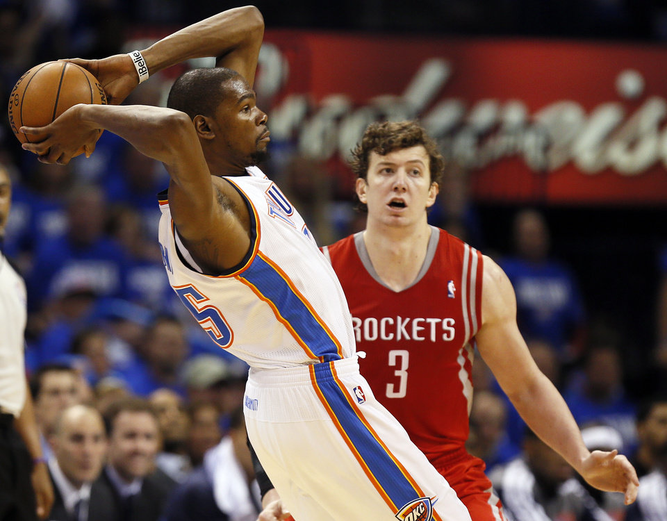 Oklahoma City\'s Kevin Durant (35) passes away from Houston\'s Omer Asik (3) during Game 1 in the first round of the NBA playoffs between the Oklahoma City Thunder and the Houston Rockets at Chesapeake Energy Arena in Oklahoma City, Sunday, April 21, 2013. Photo by Nate Billings, The Oklahoman