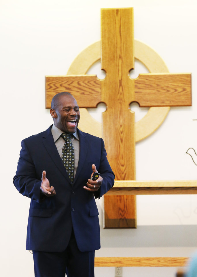 Photo -       Pastor Ron Williams guest-preaches at the Community of Grace Presbyterian Church in Sandy, Utah Sunday, Aug. 17, 2014. Williams, a nondenominational Christian pastor who was abandoned as a kid, raised by strangers, lost and couldn't read until he found God at age 28, became internationally famous body builder, fitness instructor, author and preacher. (Jeffrey D. Allred, Deseret News)