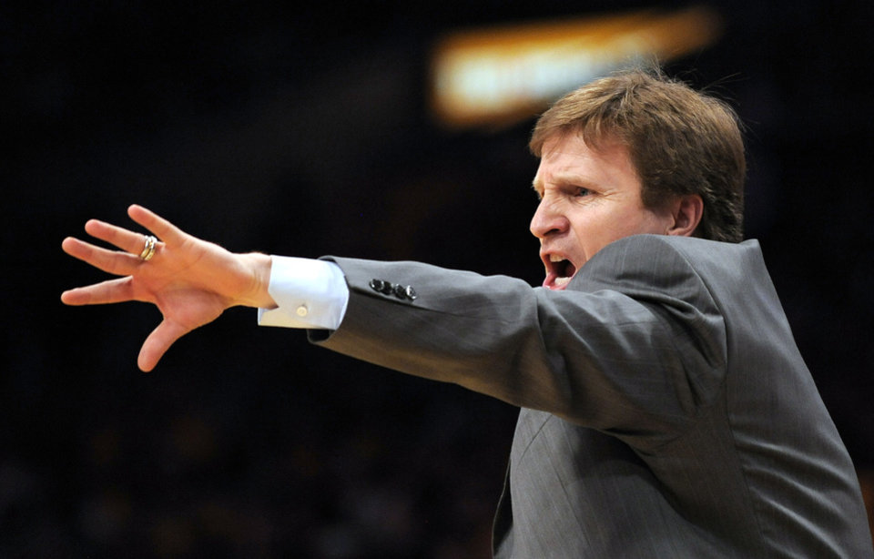 Photo - L.A. LAKERS / NBA PLAYOFFS: Oklahoma City Thunder coach Scott Brooks yells to his team during the second half  against the Los Angeles Lakers in the opening game of a first-round NBA basketball playoff series, Sunday, April 18, 2010, in Los Angeles. The Lakers won 87-79. (AP Photo/Mark J. Terrill) ORG XMIT: LAS105