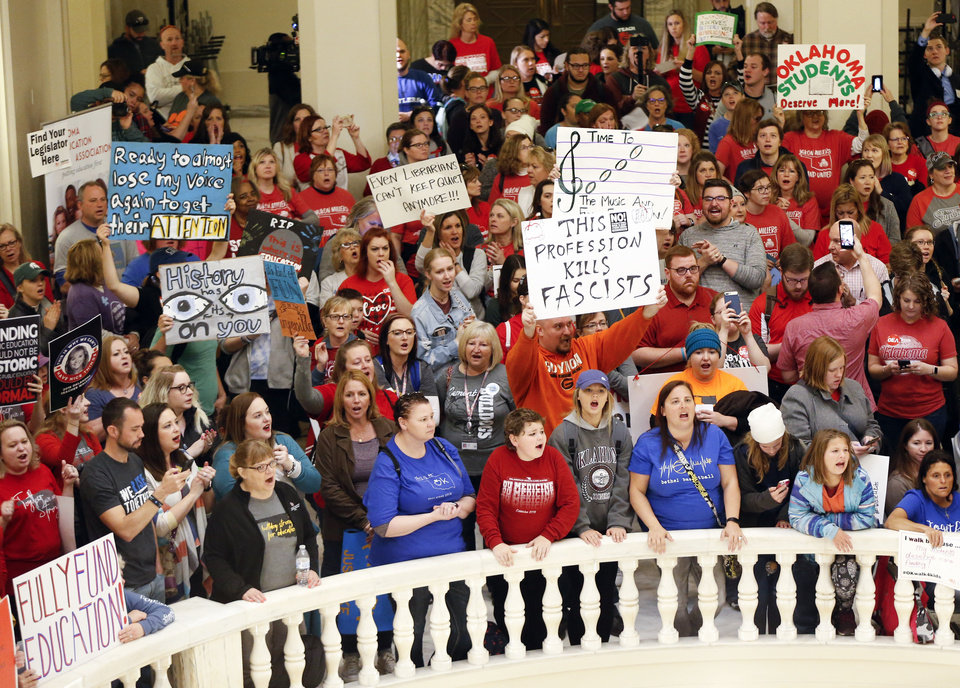 Photo - Teachers and supporters of increased education funding rally on second floor rotunda of the state Capitol during the second day of a walkout by Oklahoma teachers, in Oklahoma City, Tuesday, April 3, 2018. Photo by Nate Billings, The Oklahoman