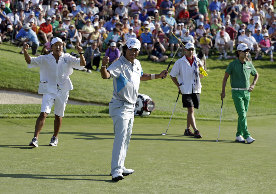 Photo - Hideki Matsuyama, foreground, of Japan, celebrates after winning the Memorial golf tournament in a playoff on Sunday, June 1, 2014, in Dublin, Ohio. (AP Photo/Darron Cummings)