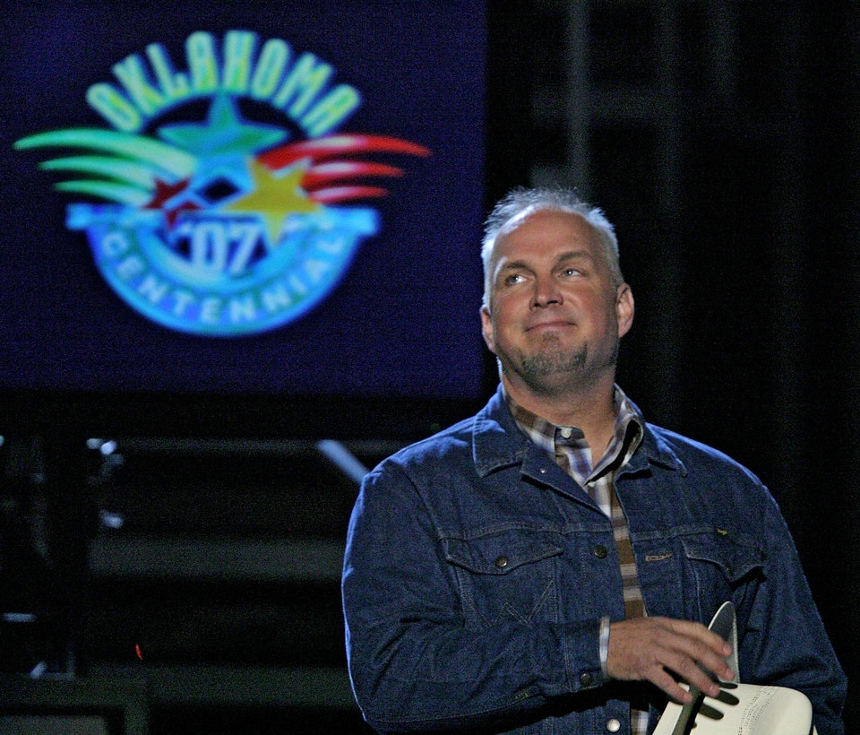 Photo - Garth Brooks is greeted by the fans during the Centennial Spectacular to celebrate the 100th birthday of the State of Oklahoma at the Ford Center on Friday, Nov. 16, 2007, in Oklahoma City, Okla. Photo By CHRIS LANDSBERGER, The Oklahoman