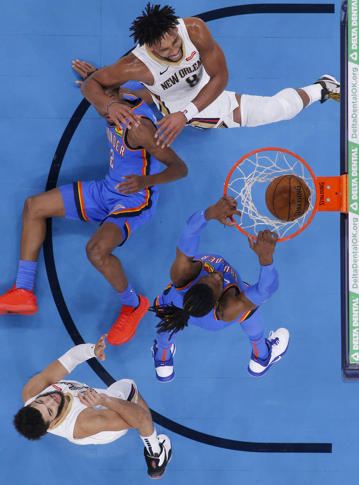 Photo - Oklahoma City's Nerlens Noel (9) dunks the ball during an NBA basketball game between the Oklahoma City Thunder and the New Orleans Pelicans at Chesapeake Energy Arena in Oklahoma City, Saturday, Nov. 2, 2019. Oklahoma City won 115-104. [Bryan Terry/The Oklahoman]
