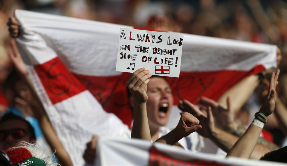 Photo - England fans holds up a banner after the group D World Cup soccer match between Costa Rica and England at the Mineirao Stadium in Belo Horizonte, Brazil, Tuesday, June 24, 2014. (AP Photo/Jon Super)