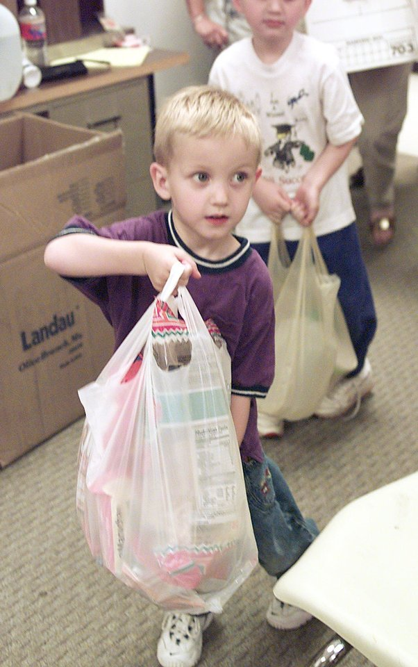 CONNER MCNEELY MAKES A DONATION TO THE RED CROSS IN NORMAN FOR TORNADO VICTIMS OF MOORE.