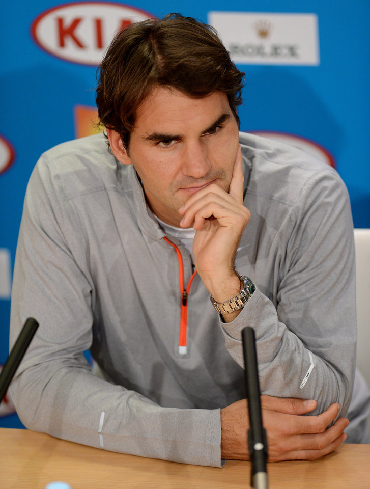 Photo - Switzerland's Roger Federer answers questions at a press conference following his loss to Britain's Andy Murray in their semifinal at the Australian Open tennis championship in Melbourne, Australia, Saturday, Jan. 26, 2013. (AP Photo/Andrew Brownbill)