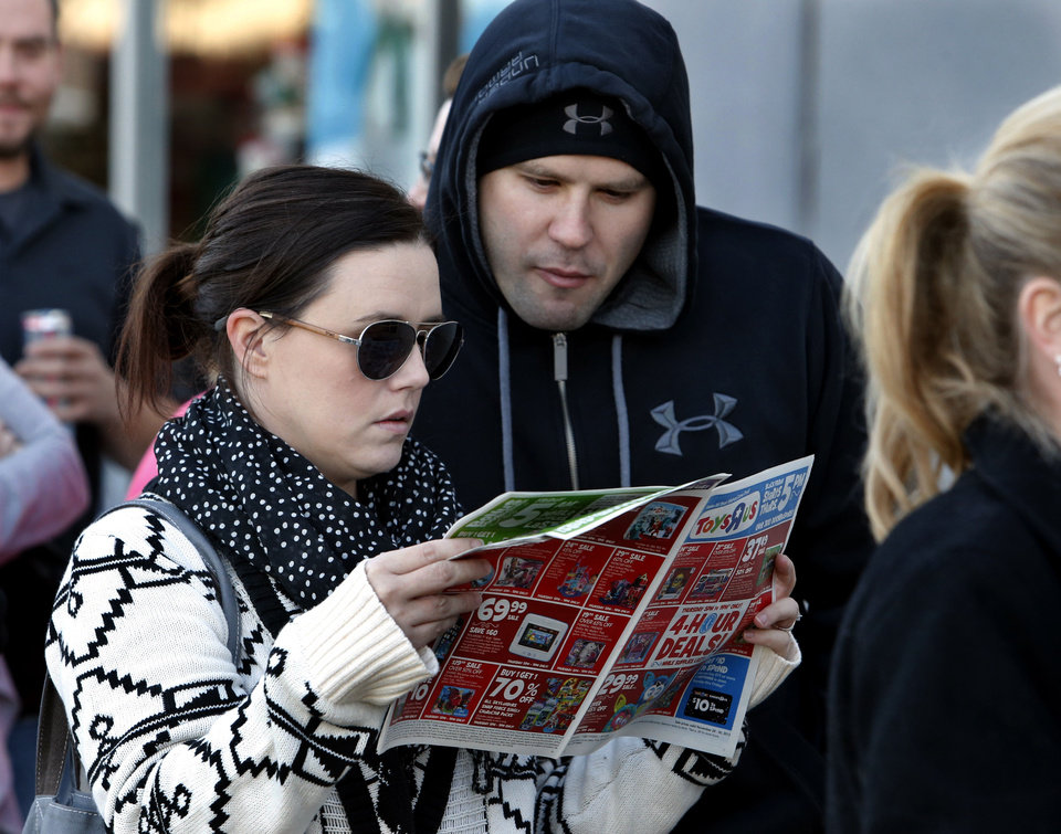 Photo - Jennifer and Kyle English get an early start on Black Friday as they wait in line at Toys