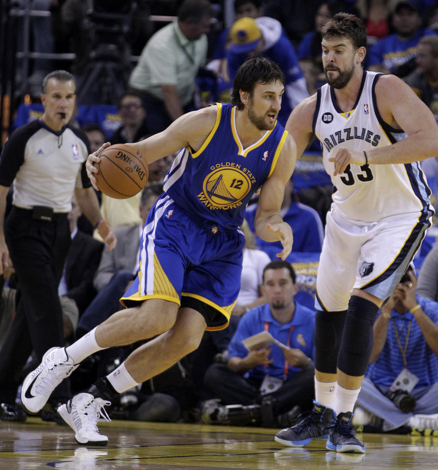 Golden State Warriors\' Andrew Bogut, left, drives the ball against Memphis Grizzlies\' Marc Gasol (33) during the first half of an NBA basketball game Friday, Nov. 2, 2012, in Oakland, Calif. (AP Photo/Ben Margot)