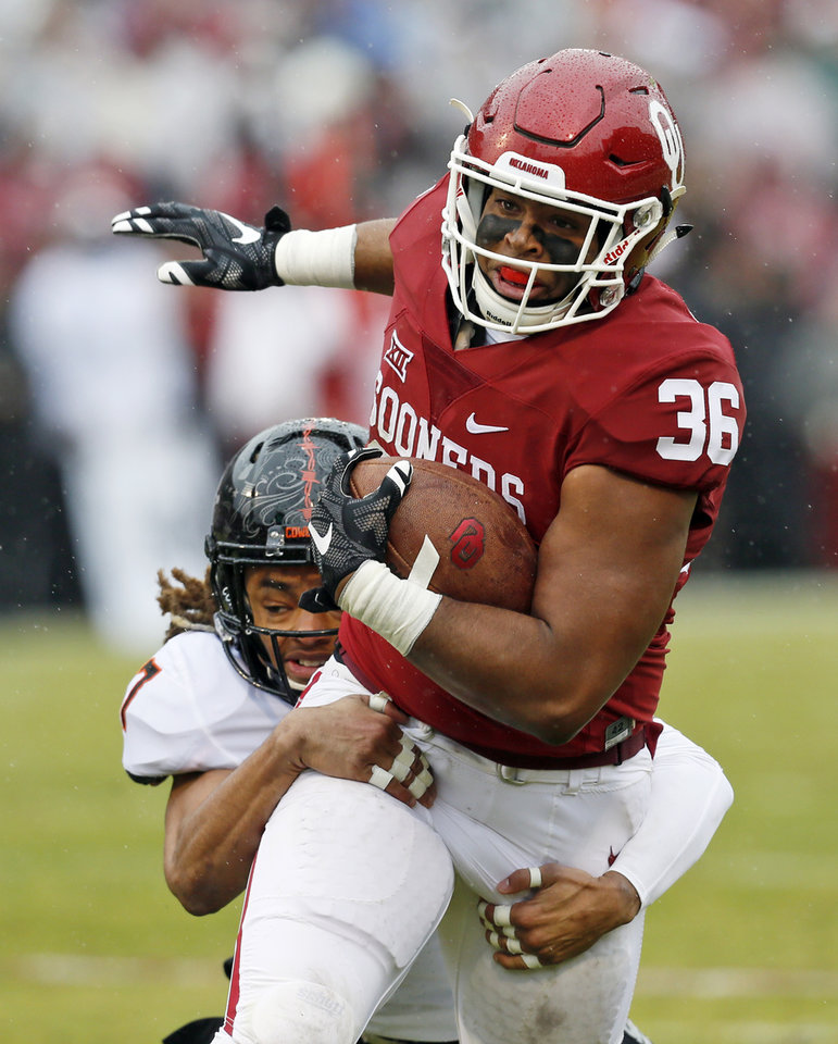 Photo - Oklahoma State's Ramon Richards (7) tackles Oklahoma's Dimitri Flowers (36) after a catch in the second quarter during the Bedlam college football game between the Oklahoma Sooners (OU) and the Oklahoma State Cowboys (OSU) at Gaylord Family - Oklahoma Memorial Stadium in Norman, Okla., Saturday, Dec. 3, 2016. Photo by Nate Billings, The Oklahoman