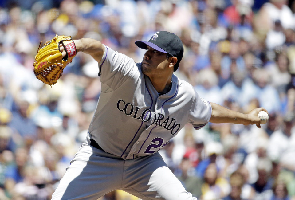 Photo - Colorado Rockies starting pitcher Jorge De La Rosa throws during the first inning of a baseball game against the Milwaukee Brewers Sunday, June 29, 2014, in Milwaukee. (AP Photo/Morry Gash)
