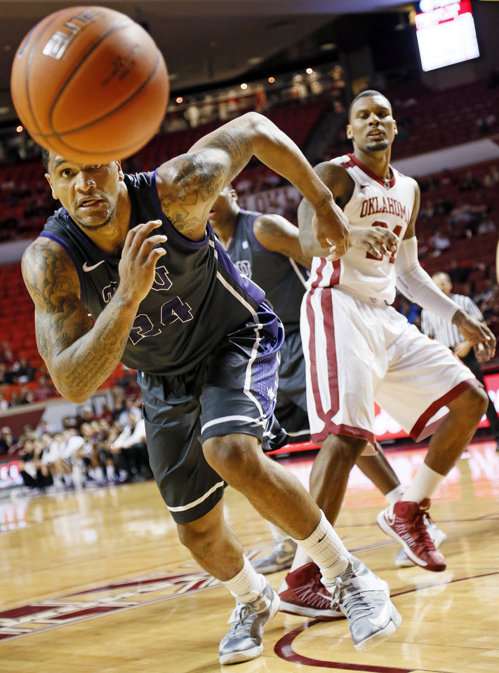 Photo - TCU's Adrick McKinney (24) chases a loose ball in front of Oklahoma's Romero Osby (24) during an NCAA men's basketball game between the University of Oklahoma (OU) and Texas Christian University (TCU) at the Lloyd Noble Center in Norman, Okla., Monday, Feb. 11, 2013. OU won, 75-48. Photo by Nate Billings, The Oklahoman