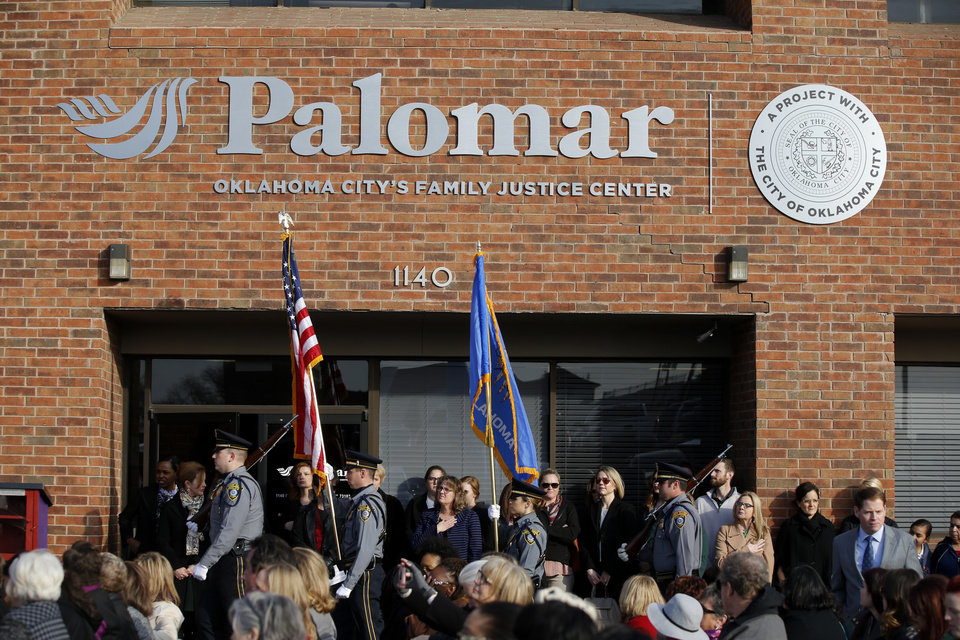 Photo -  An Oklahoma City Police Honor Guard presents the colors during a grand opening for Palomar, Oklahoma City's Family Justice Center. [Photo by Bryan Terry, The Oklahoman]