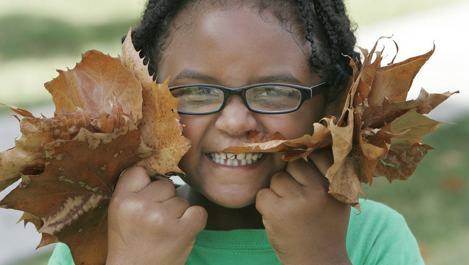 Lindsay Wilson, 6, with the Community After School (summer) Program (CAPS) shows the leaves she collected at Andrews Park Tues. July 28, 2009 in Norman. Photo by Jaconna Aguirre, The Oklahoman