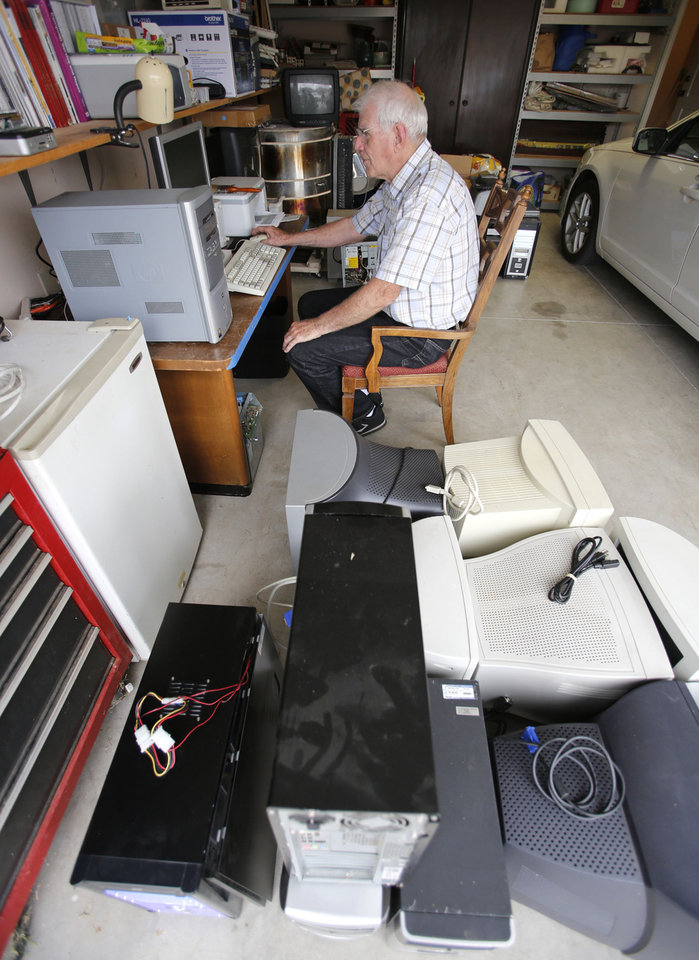 Dave Stewart works on a computer in his garage in Oklahoma City. Photo By Steve Gooch, The Oklahoman <strong>Steve Gooch - The Oklahoman</strong>