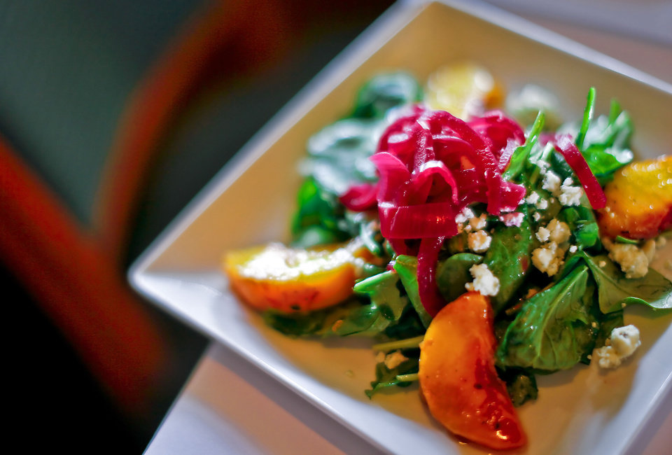 Seasonal Grilled Peach Salad prepared by Chef Christine Dowd at The Metro Wine Bar and Bistro, where she is the new executive chef. <strong>CHRIS LANDSBERGER - THE OKLAHOMAN</strong>
