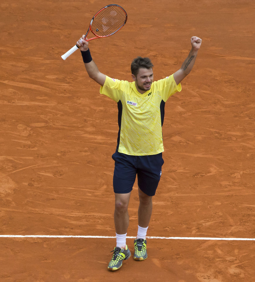Photo - Stanislas Wawrinka of Switzerland, celebrates after defeating David Ferrer of Spain during their semifinal match of the Monte Carlo Tennis Masters tournament in Monaco, Saturday, April 19, 2014. Wawrinka won 6-1 7-6. (AP Photo/Michel Euler)