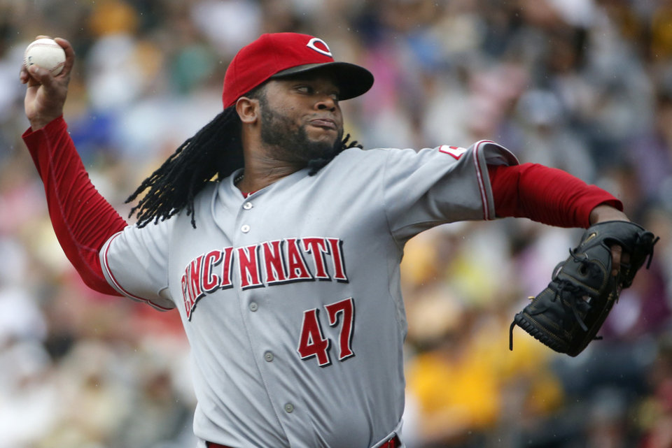 Photo - Cincinnati Reds starting pitcher Johnny Cueto delivers during the first inning of a baseball game against the Pittsburgh Pirates in Pittsburgh, Sunday, Aug. 31, 2014. (AP Photo/Gene J. Puskar)