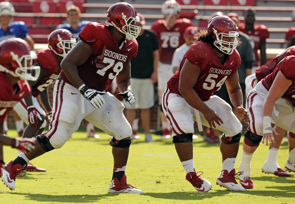 Photo - Daryl Williams (79) and Nila Kasitati (54) guard the quarterback during the University of Oklahoma Sooners (OU) practice and Student Day at Gaylord Family-Oklahoma Memorial Stadium in Norman, Okla., on Thursday, Aug. 21, 2014. Photo by Steve Sisney, The Oklahoman