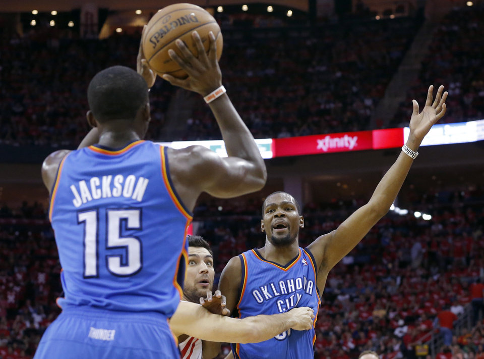 Oklahoma City's Reggie Jackson (15) looks to pass the ball to Kevin Durant (35) during Game 4 in the first round of the NBA playoffs between the Oklahoma City Thunder and the Houston Rockets at the Toyota Center in Houston, Texas, Monday, April 29, 2013. Photo by Bryan Terry, The Oklahoman