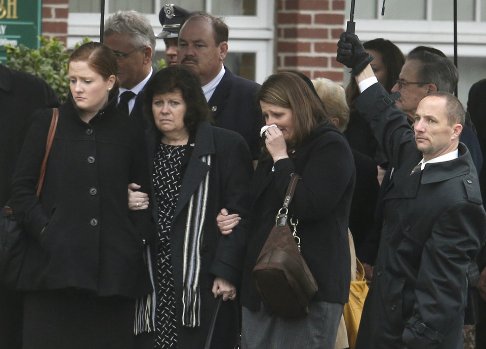 Mourners enter St. Patrick's Church in Stoneham, Mass., before a funeral Mass for Massachusetts Institute of Technology police officer Sean Collier, Tuesday, April 23, 2013. Collier was fatally shot on the MIT campus Thursday, April 18, 2013. Authorities allege that the Boston Marathon bombing suspects were responsible. (AP Photo/Steven Senne)