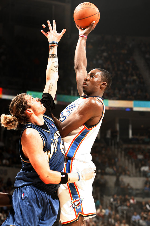 Photo - Jeff Green (22) shoots over Mike Miller (6) during the first half as the Oklahoma City Thunder NBA basketball team plays the Washington Wizards at the Ford Center on Friday, Nov. 20, 2009, in Oklahoma City, Okla.  Photo by Steve Sisney, The Oklahoman ORG XMIT: KOD