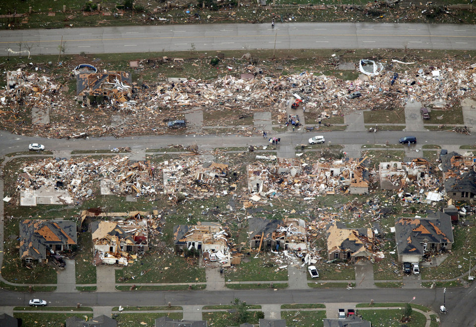 Photo - The houses on this street were destroyed by the May 20th tornado in Moore, OK, Tuesday, May 21, 2013,  By Paul Hellstern, The Oklahoman