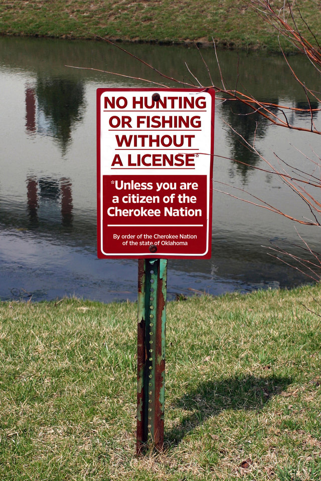 Photo - CHEROKEE NATION TRIBAL CITIZENSHIP CARD / CHEROKEE HUNTING AND FISHING CODE: No hunting or fishing without a license SIGN 		PHOTO FROM STOCK.XCHNG.COM; ILLUSTRATION BY BILL BOOTZ, THE OKLAHOMAN 			ORG XMIT: 0907032144215824