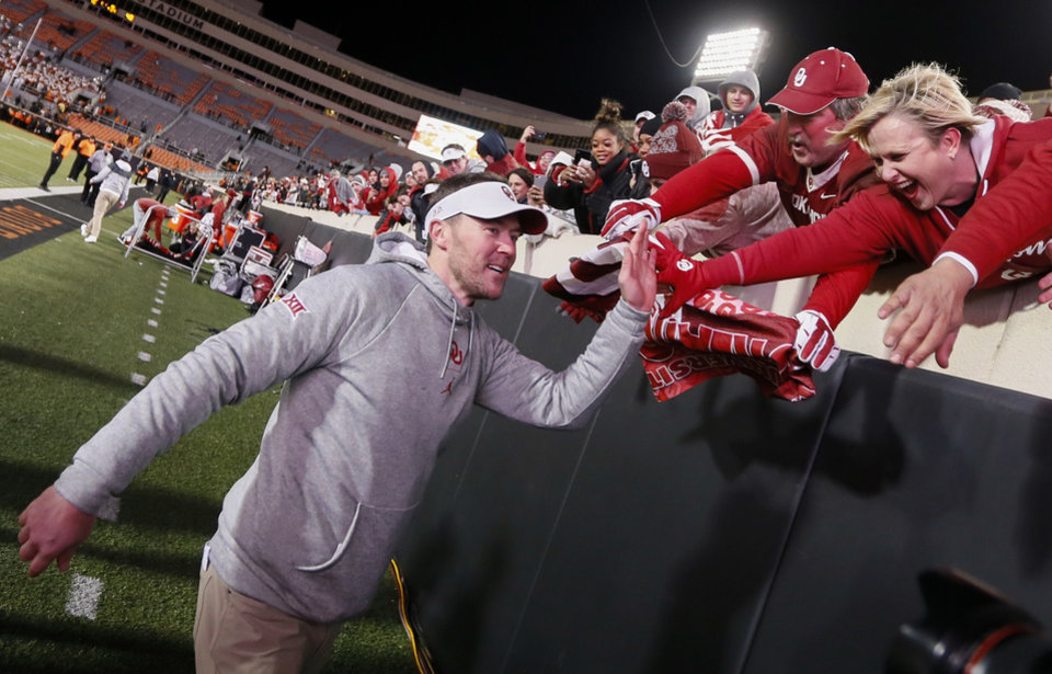 Photo - OU head coach Lincoln Riley celebrates with fans after the Bedlam college football game between the Oklahoma State Cowboys (OSU) and Oklahoma Sooners (OU) at Boone Pickens Stadium in Stillwater, Okla., Saturday, Nov. 30, 2019. OU won 34-16. [Nate Billings/The Oklahoman]