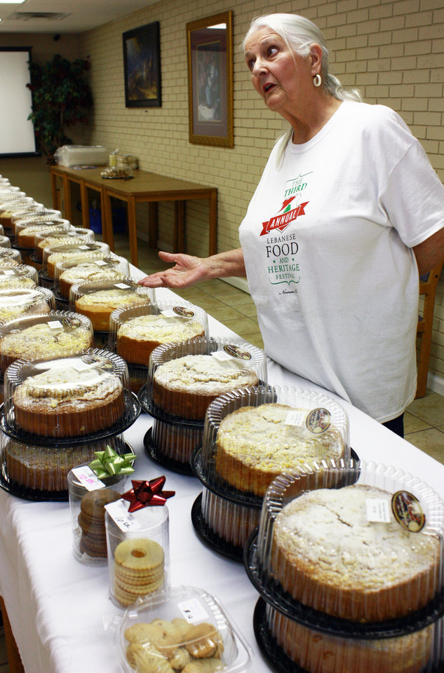 Photo -  Sue Schofield sells baked goods at the third annual Lebanese Heritage and Food Festival at Our Lady of Lebanon Church in Norman. PHOTO BY LYNETTE LOBBAN, FOR THE OKLAHOMAN