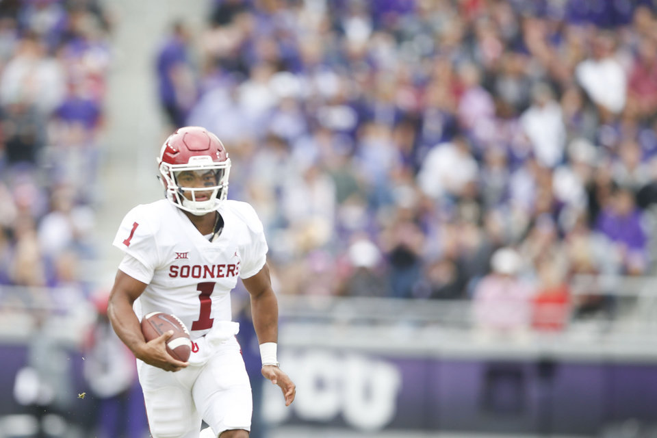 Photo - Oklahoma Sooners quarterback Kyler Murray (1) scrambles for yards during the NCAA football game between the TCU Horned Frogs and the Oklahoma Sooners at Amon G. Carter Stadium in Fort Worth, Texas on Saturday, October 20, 2018. IAN MAULE/Tulsa World