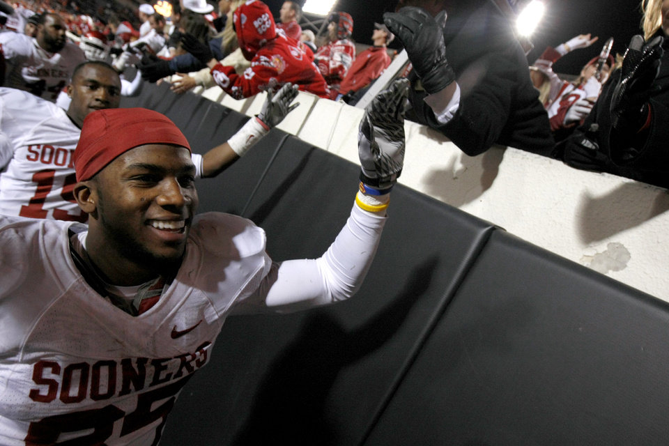 Photo - Oklahoma's Ryan Broyles (85) celebrates after  the Bedlam college football game between the University of Oklahoma Sooners (OU) and the Oklahoma State University Cowboys (OSU) at Boone Pickens Stadium in Stillwater, Okla., Saturday, Nov. 27, 2010. Photo by Bryan Terry, The Oklahoman