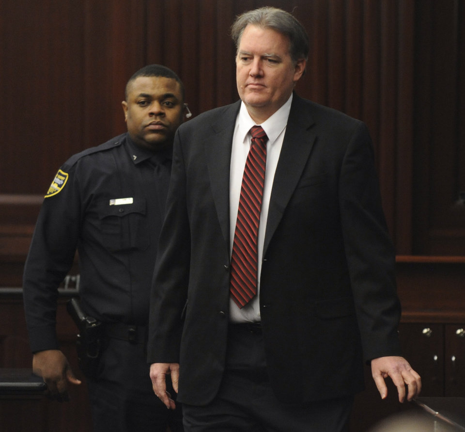 Photo - Defendant Michael Dunn is brought into the courtroom just before 5 p.m., where Judge Russell Healey announced that the jury was deadlocked on charge one and have verdicts on the other four charges as they deliberate in the trial of Dunn, Saturday Feb. 15, 2014 for the shooting death of Jordan Davis in November 2012. Dunn is charged with fatally shooting 17-year-old Davis after an argument over loud music outside a Jacksonville convenient store. (AP Photo/The Florida Times-Union, Bob Mack, Pool)