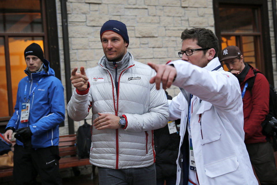 Photo - Norway's Aksel Lund Svindal, centre, gestures during a media briefing in the Rosa Khutor ski resort in Krasnaya Polyana, Russia at the Sochi 2014 Winter Olympics, Monday, Feb. 17, 2014. Svindal is leaving the Olympics because he has problems with allergies and fatigue, the Norwegian men's Alpine skiing coach said Monday. (AP Photo/Christophe Ena)