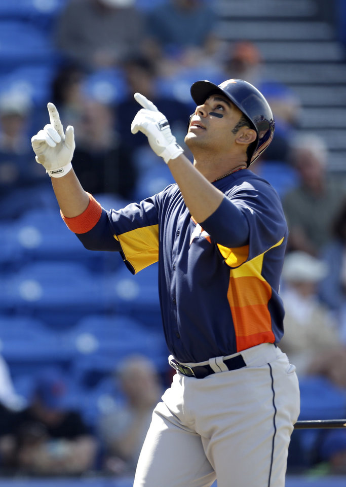Houston Astros' Carlos Pena celebrates after hitting a 2-run home run during the fourth inning of an exhibition spring training baseball game against the New York Mets Saturday, March 9, 2013, in Port St. Lucie, Fla. (AP Photo/Jeff Roberson)