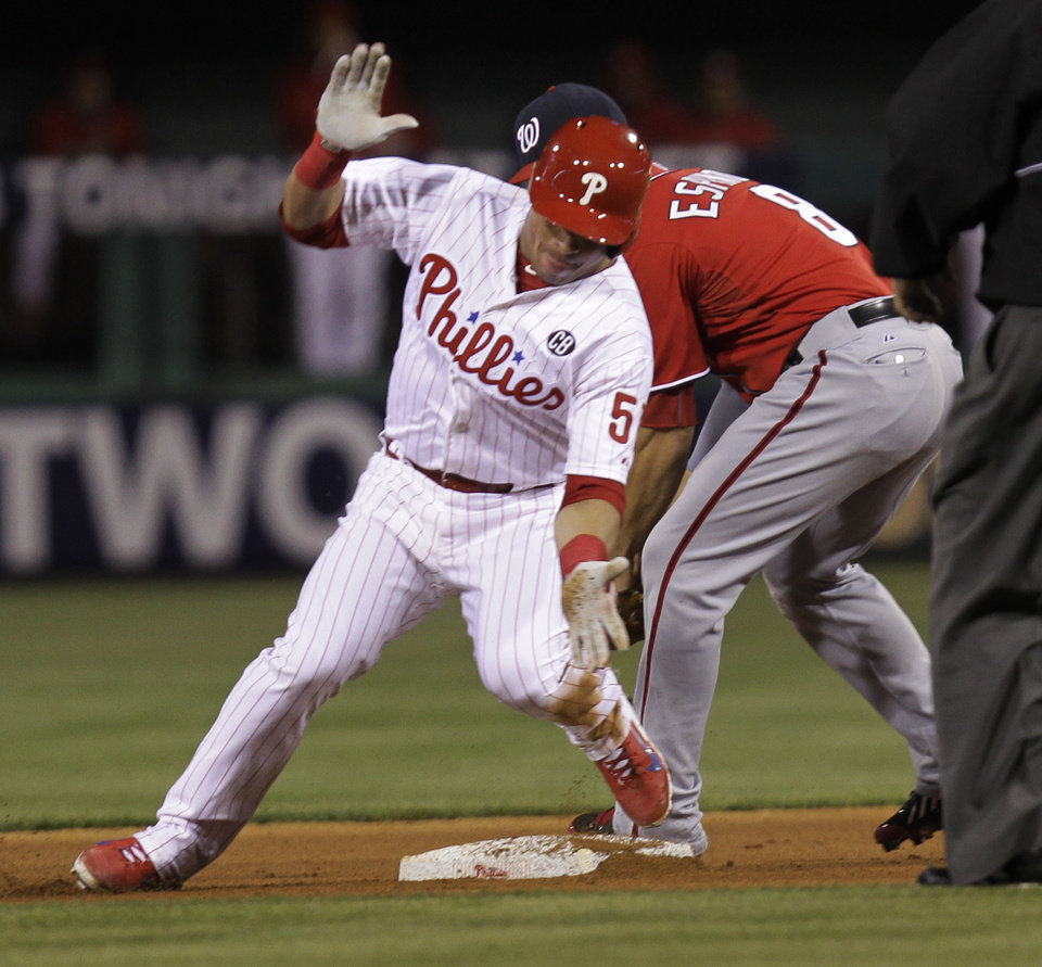Photo - Philadelphia Phillies' Carlos Ruiz, front, is safe at second on a double before Washington Nationals' Danny Espinosa can make the tag in the fourth inning of a baseball game on Saturday, May 3, 2014, in Philadelphia. (AP Photo/Laurence Kesterson)