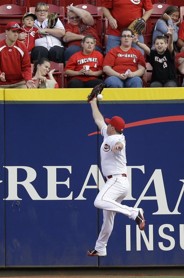 Photo - Cincinnati Reds right fielder Jay Bruce just misses catching a double hit by Arizona Diamondbacks' Mark Trumbo in the fourth inning of a baseball game, Monday, July 28, 2014, in Cincinnati. (AP Photo/Al Behrman)