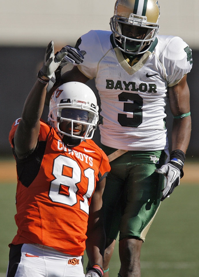 Oklahoma State's Justin Blackmon (81)signals for a first down in front of Baylor's Lanear Sampson (3) after a reception during the college football game between the Oklahoma State University Cowboys (OSU) and the Baylor University Bears at Boone Pickens Stadium in Stillwater, Okla., Saturday, Nov. 6, 2010. Photo by Chris Landsberger, The Oklahoman