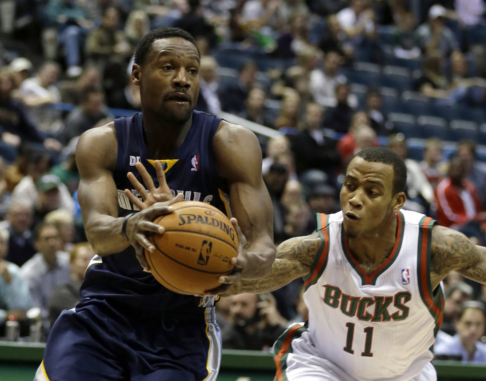 Milwaukee Bucks\' Monta Ellis (11) reaches in on Memphis Grizzlies\' Tony Allen during the first half of an NBA basketball game, Wednesday, Nov. 7, 2012, in Milwaukee. (AP Photo/Jeffrey Phelps)