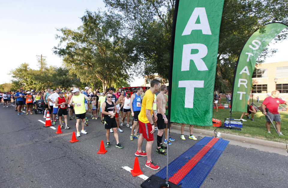 Photo -  Runners line up last year for the 5K to Monet race in downtown Edmond. Photo by Paul Hellstern, The Oklahoman Archives   PAUL HELLSTERN -  Oklahoman