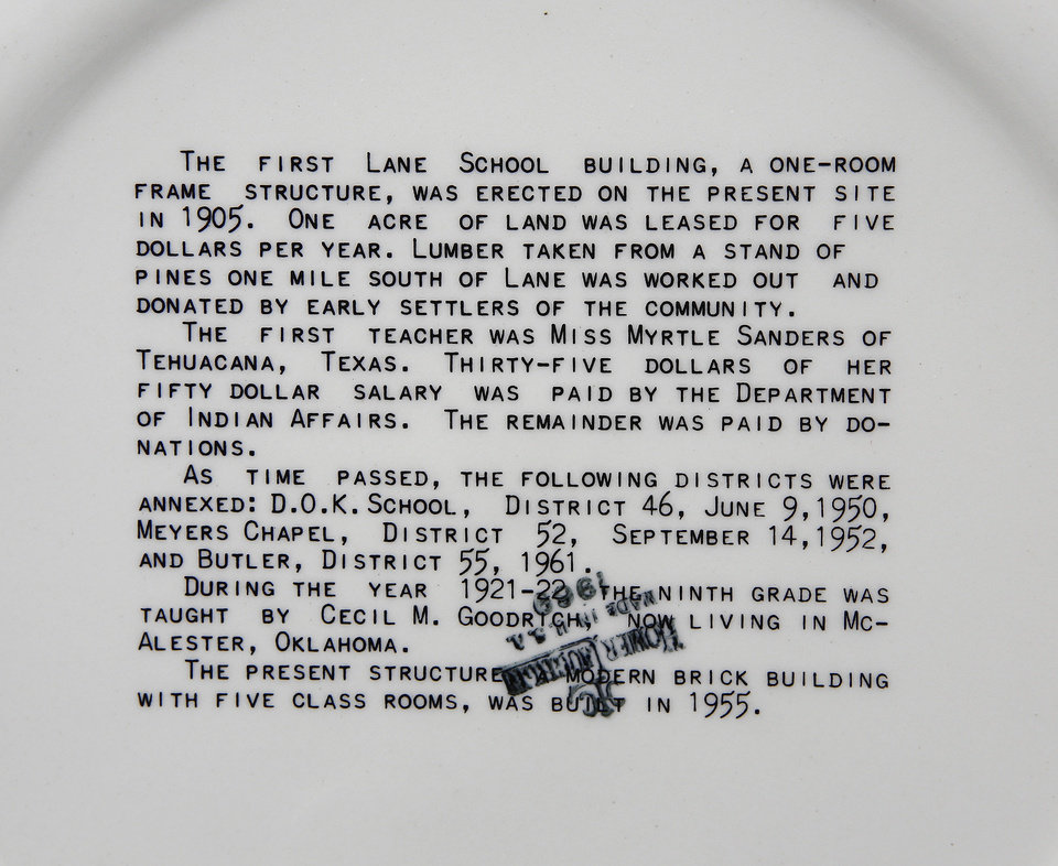 Photo - A 1961 commemorative plate features a brief history  of Lane School on the bottom of the plate. About 50 students transferred to Lane Public School after their former school, Farris School, was annexed by Lane in Atoka County.   Photo taken  March 1, 2013. Photo by Jim Beckel, The Oklahoman
