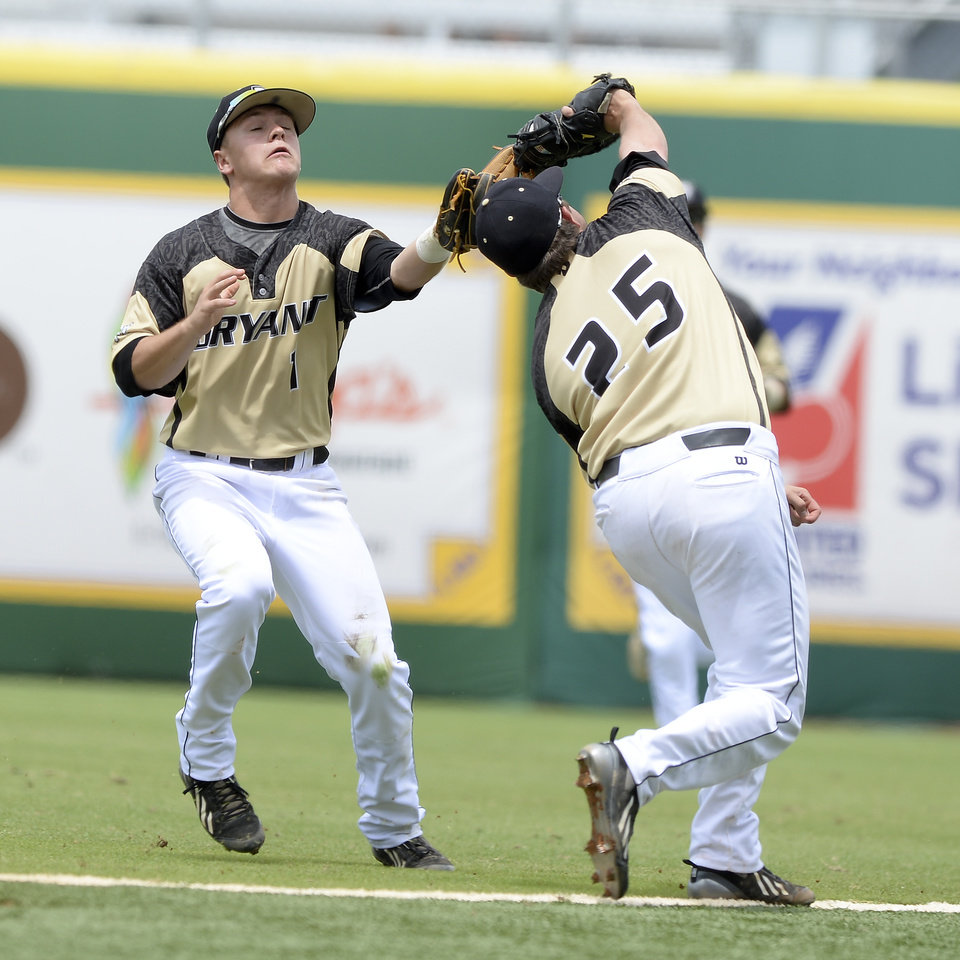 Photo - Bryant's Cole Fabio (1) and Robby Rinn (25) both chase after a popup until Rinn makes the catch against Southeastern Louisiana on Saturday, May 31, 2014, during the first round of an NCAA college baseball regional tournament in Baton Rouge, La. (AP Photo/The Baton Rouge Advocate, Hilary Scheinuk) NO SALES; MAGAZINES OUT; INTERNET OUT;TV OUT; NO FOREIGNS. LOUISIANA BUSINESS INC. OUT (INCLUDING GREATER BATON ROUGE BUSINESS REPORT; 225; 10/12; INREGISTER; LBI CUSTOM MAGS OUT/  INTERNET OUT/ ONLINE OUT/ NO SALES/  TV OUT/  FOREIGN OUT/ LOUISIANA BUSINESS INC. OUT (INCLUDING GREATER BATON ROUGE BUSINESS REPORT, 225, 10/12, INREGISTER, LBI CUSTOM PUBLICATIONS) MANDATORY CREDIT THE ADVOCATE