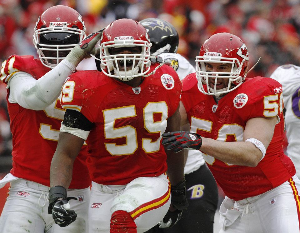 FILE - In this Jan. 9, 2011, file photo, Kansas City Chiefs linebacker Jovan Belcher, center, reacts with teammates after sacking Baltimore Ravens quarterback Joe Flacco during the second quarter of an NFL AFC wild card football playoff game in Kansas City, Mo. Police say Belcher fatally shot his girlfriend early Saturday, Dec. 1, 2012, in Kansas City, Mo., then drove to Arrowhead Stadium and committed suicide in front of his coach and general manager.(AP Photo/Jeff Tuttle, File)
