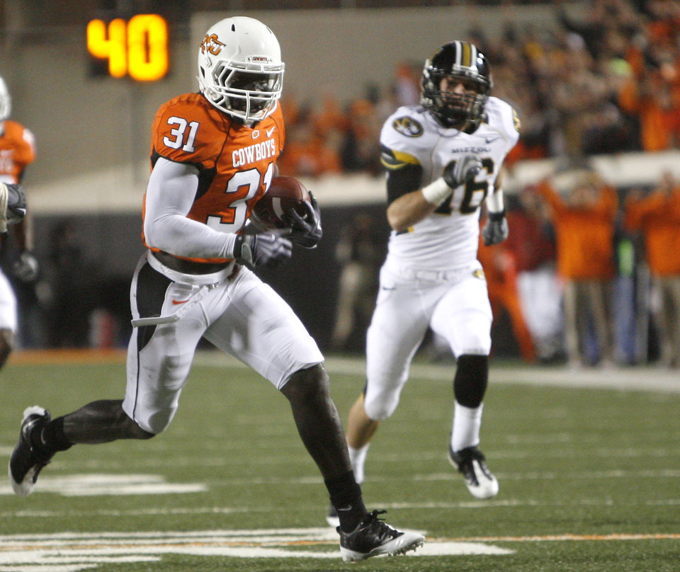Photo - OSU's Lucien Antoine (31) scores a touchdown off a interception during the college football game between Oklahoma State University (OSU) and the University of Missouri (MU) at Boone Pickens Stadium in Stillwater, Okla. Saturday, Oct. 17, 2009.  Photo by Sarah Phipps, The Oklahoman ORG XMIT: KOD