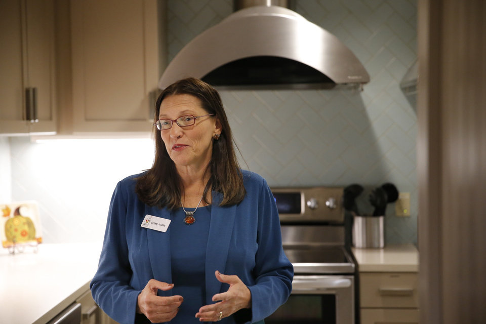 Photo -  Susan Adams talks about the Ronald McDonald House at Garrison Tower on Thursday in Oklahoma City. [Photo by Sarah Phipps, The Oklahoman]