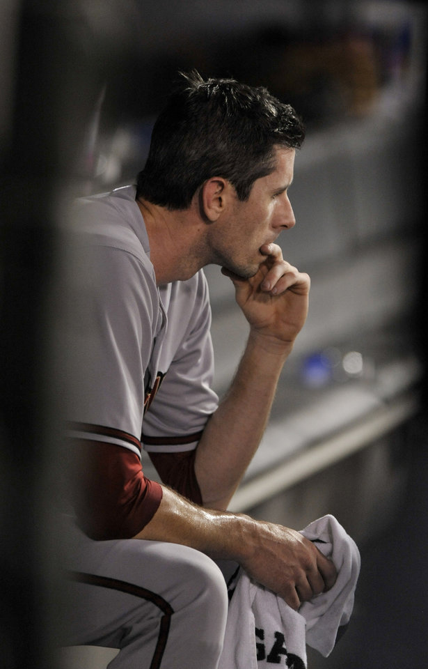 Photo - Arizona Diamondbacks starting pitcher Brandon McCarthy looks on in the dugout after being pulled during the fourth inning of a baseball game against the Chicago White Sox in Chicago, Friday, May 9, 2014. (AP Photo/Paul Beaty)