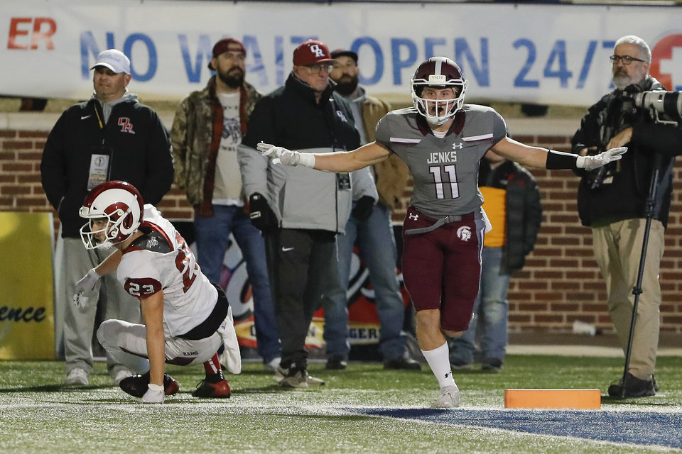 Photo - Jenks Quinn Hill (11) celebrates after OwassoÕs Trey Goins (23) misses a pass in the end zone during the first quarter of the OSSAA 6A-1 Championship game in Edmond, Okla., Saturday, Dec. 7, 2019. (Alonzo Adams for The Oklahoman)